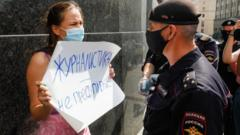 Protester confronting police over Safronov arrest in Moscow, 7 Jul 20