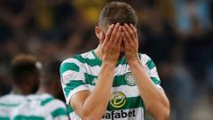 Celtic's Jozo Simunovic looks dejected after the match