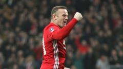 Wayne Rooney celebrating
