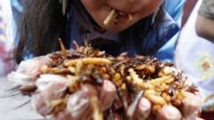 Close up of women eating fried insects