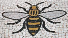 A Manchester Worker Bee incorporated into the floor of the Town Halll in Manchester.
