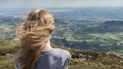 Girl looks out at Slieve Gullion in Northern Ireland