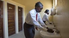 Children in Zambia using their school toilets