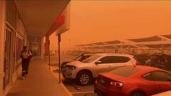 red-sky-parked-cars-and-person-walking.