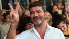 Simon Cowell looking happy