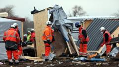 Demolition workers destroy huts as they clear part of the 'jungle' migrant camp on March 01, 2016 in Calais, France. Police and demolition teams are continuing to dismantle makeshift shelters in the migrant camp known as the 'Jungle' and relocating many people to purpose-built accommodation nearby.