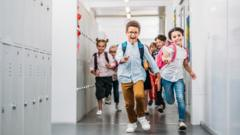 Kids-running-through-school-corridor.