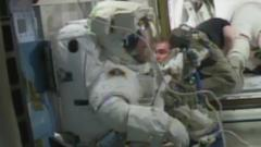 Tim Peake in his spacesuit ready to go in to the spacelock