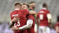 Players hug after the Lions' first test
