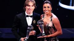 Winners Luka Modric and Marta