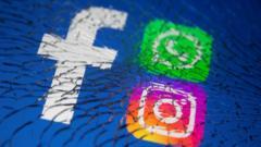 Facebook, Whatsapp and Instagram logo behind cracked screen.