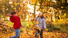 Children-playing-in-leaves.