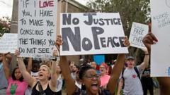 Police and protesters demonstrate in a residential neighborhood in Baton Rouge, La. on Sunday, July 10, 2016.