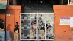 Police officers stand guard outside a Lahore district jail where the special court announced its verdict. Photo: 20 March 2021
