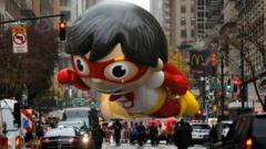"""A balloon depicting Red Titan, a character from """"Ryan""""s World"""", is seen during the 94th Macy""""s Thanksgiving Day Parade closed to the spectators due to the spread of the coronavirus disease (COVID-19), in Manhattan, New York City, U.S., November 26, 2020"""