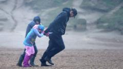 Storm-Ciara-a-family-walk-against-the-wind-during-the-storm.