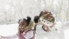 two-girls-play-in-snow
