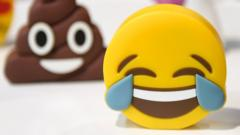 Laughing face and poo emoji