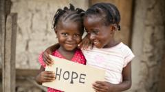 Girls holding a sign saying hope