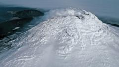 icy-volcano-with-steam-at-crater