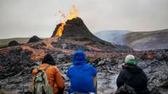 hikers-watching-volcano-at-the Fagradalsfjall-area-in-Iceland.