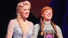 Elsa and Anna in the Frozen Musical
