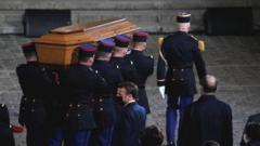 The coffin of slain teacher Samuel Paty is carried in the courtyard of the Sorbonne university
