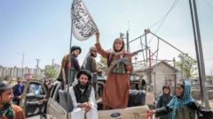Taliban fighters are seen on the back of a vehicle in Kabul, Afghanistan, 16 August 2021