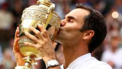 Roger Federer kissing the Wimbledon Championship trophy after winning the tennis tournament in 2017