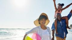 Family-cheering-on-beach.