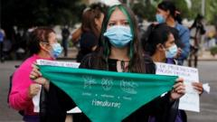 A woman holds a green handkerchief during a demonstration in favour of legalising abortion, after lawmakers approved a constitutional reform that would reinforce the ban, near the Congress in Tegucigalpa, Honduras January 25, 2021