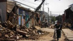 A man pushing a bicycle through a damaged street after an earthquake struck Chile in 2010.