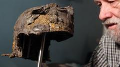 Ken Wallace with the 2,000-year-old Roman cavalry helmet he found