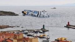 The capsized Costa Concordia lies off the coast of Giglio