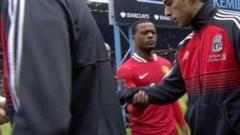 Suarez refuses Evra handshake