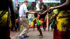 Prince and a lady do a reggae move