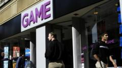 Shoppers pass a Game store in a high street