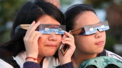 Children look through 'eclipse specs' to protect their eyes