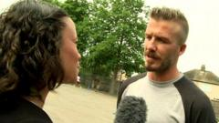 David Beckham speaking to Leah