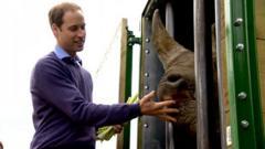 Duke of Cambridge feeding a rhino