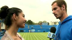 Andy Murray(R) chats to Nel(L)
