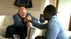 Sepp Blatter shakes hands with Ore