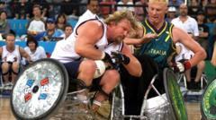 Wheelchair rugby players collide