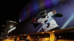 Picture of American footballer projected on to stadium in New Orleans