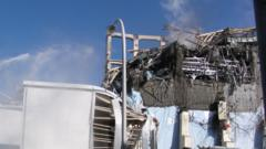 Water being discharged against unit 3 reactor building at the Fukushima Dai-ichi nuclear plant.