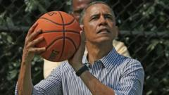 US President Barack Obama holding basketball