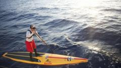 Benjamin Schiller Friberg paddles in the open sea of the Straits of Florida.