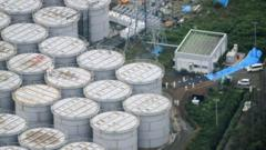 Enormous water storage tanks dwarf the workers stood on top of one of them
