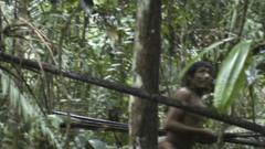 A man from the Kawahiva tribe caught on camera moving through the jungle