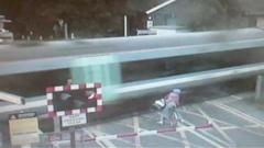 This shocking video shows a cyclist coming within seconds of being hit by a train at a level crossing in Cambridgeshire.